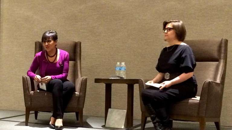 U.S. Commerce Secretary Penny Pritzker, left, talks with