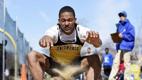 Talek Butler of Uniondale wins the boys long