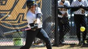St. Anthony's 3B Kim Puzo hits an RBI