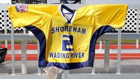 Thomas Cutinella's lacrosse uniform & equipment hang by