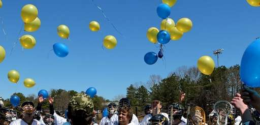 The Shoreham-Wading River lacrosse team releases balloons after