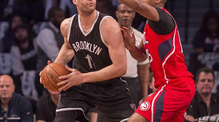 Brooklyn Nets' Brook Lopez looks to pass the