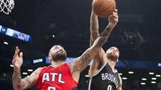 Brooklyn Nets' Deron Williams fights for a rebound
