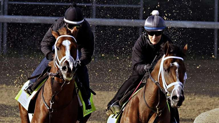 Kentucky Derby hopeful Stanford, right, ridden by exercise