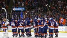The New York Islanders celebrate after defeating the