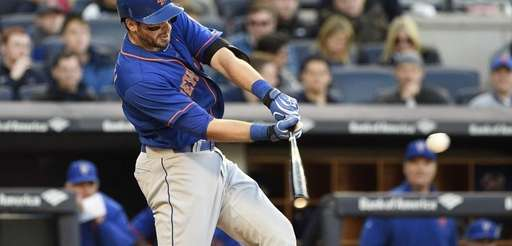 New York Mets catcher Kevin Plawecki hits an