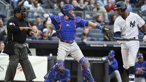 New York Mets catcher Kevin Plawecki throws the