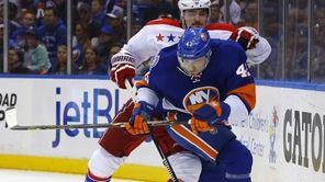 Scott Mayfield of the New York Islanders defends