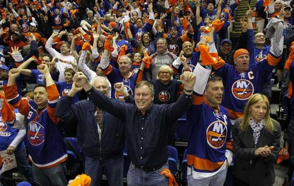 New York Islanders fans celebrate after a third-period