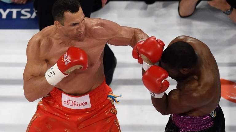 Wladimir Klitschko, left, and Bryant Jennings exchange punches