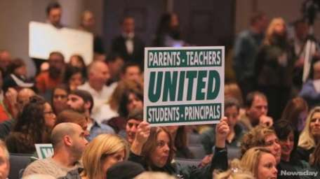 Parents protest at state Ed Dept. forum on