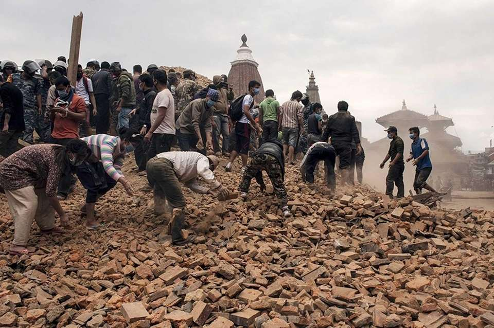 Rescue workers sift through the ruins in Kathmandu,