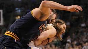 Cleveland Cavaliers forward Kevin Love, left, yells with
