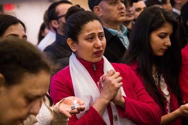 Shobha Pokharel Shrestha from Hicksville prays for the
