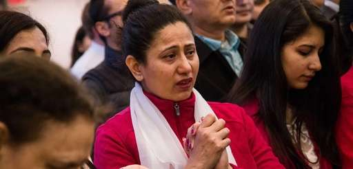 Shobha Pokharel Shrestha from Hicksville prays for the