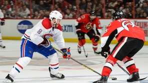 Brandon Prust of the Montreal Canadiens tries to
