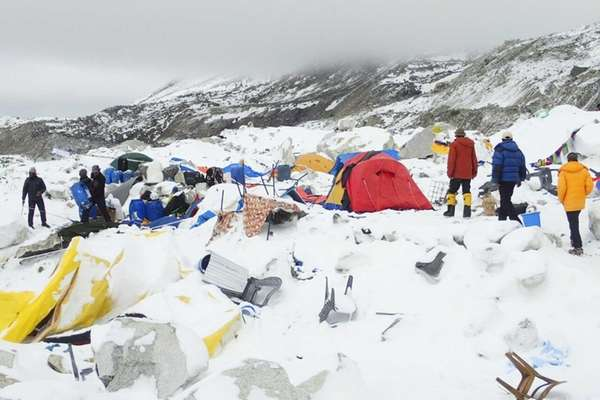 Dozens of tents lie damaged after an avalanche