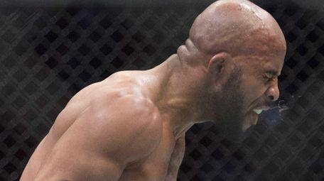 Demetrious Johnson reacts after defending his UFC 186