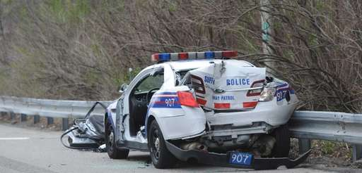 Police investigate a crash on the Long Island