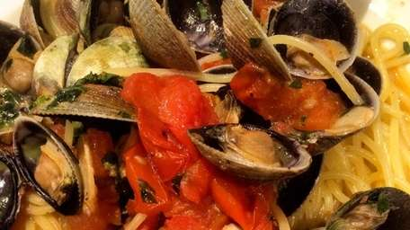 Spaghetti and clam sauce is served at the