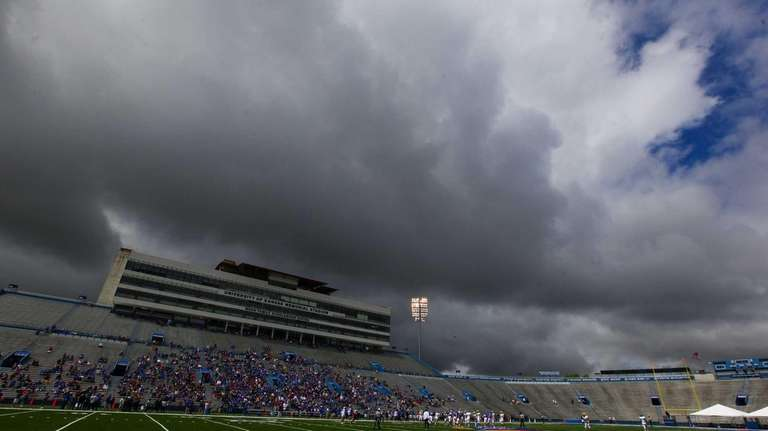 Storm clouds roll over Memorial Stadium during the