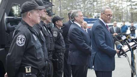 Sen. Charles Schumer, far right, is joined by