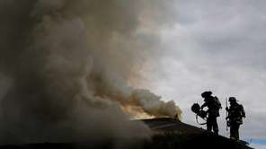 Firefighters battle a blaze Monday, April 27, 2015,