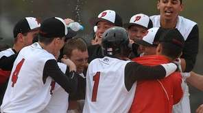 Plainedge teammates celebrate after their 4-3 walkoff victory