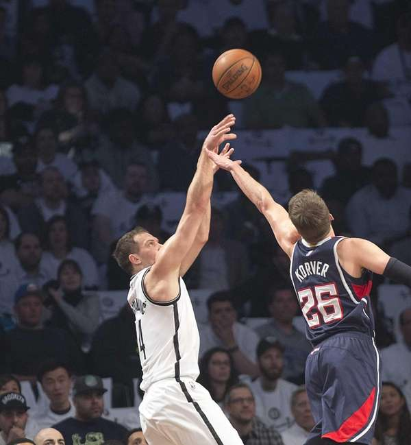 The Brooklyn Nets' Bojan Bogdanovic shoots over Kyle