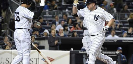 New York Yankees designated hitter Carlos Beltran greets