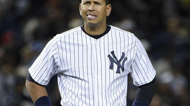 New York Yankees third baseman Alex Rodriguez stands