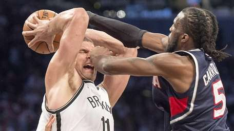 The Brooklyn Nets' Brook Lopez fights to keep