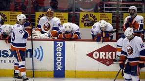 The New York Islanders react after Game 7