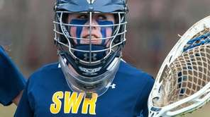 Shoreham-Wading River goalie Lauren Daly looks on during