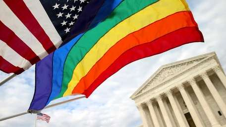 An American flag and a rainbow colored flag