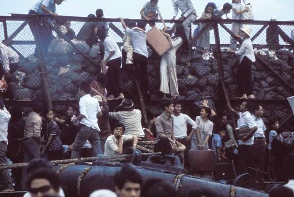 April 29, 1975. Desperate South Vietnamese clamber aboard