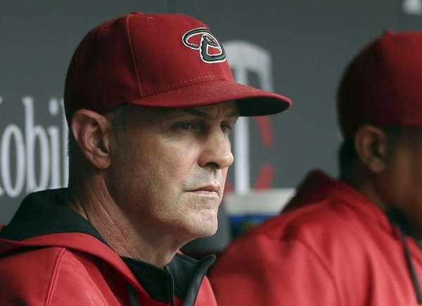 Arizona Diamondbacks manager Kirk Gibson watches from the