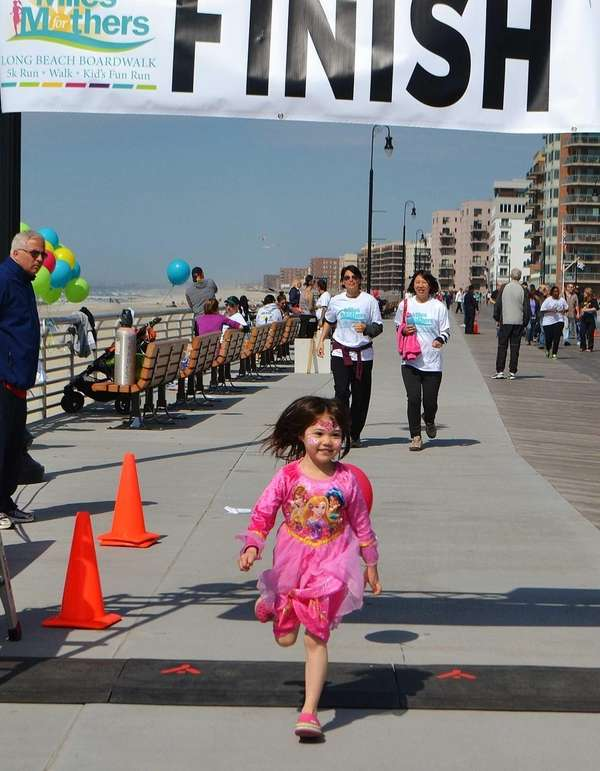 A child crosses the finish line in the