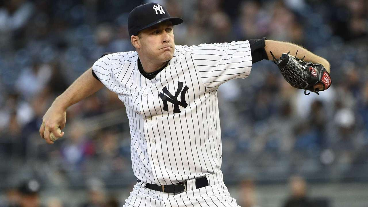 New York Yankees starting pitcher Chase Whitley delivers