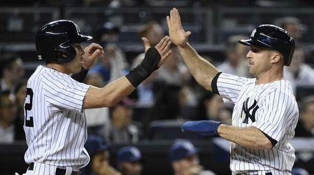Yankees centerfielder Jacoby Ellsbury and Yankees leftfielder Brett