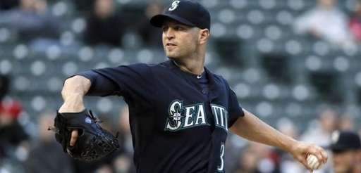Seattle Mariners' J.A. Happ delivers to the Texas