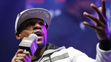 Floyd Mayweather Jr. speaks during an arrival ceremony
