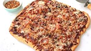Pizza topped with bacon, onions caramelized in bacon