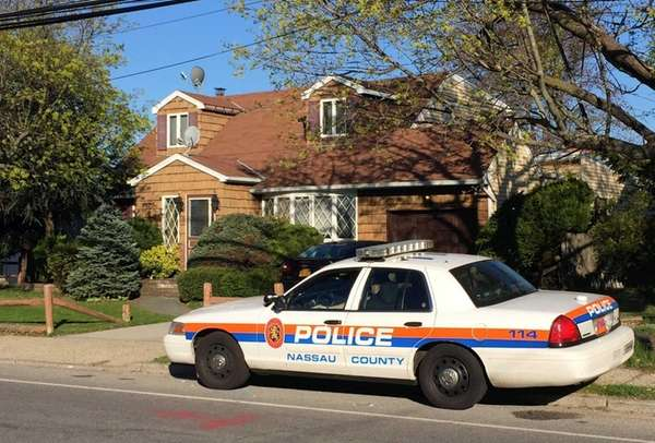 A police cruiser outside a home on Prospect