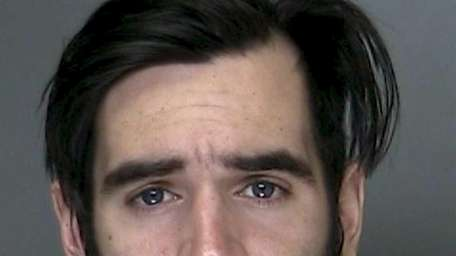 Christopher Collins, 25, of Ridge, was arrested on
