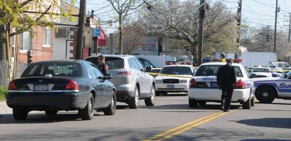 Suffolk County police respond to a shooting at