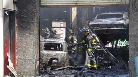 Firefighters battle a blaze at Mean Street Custom
