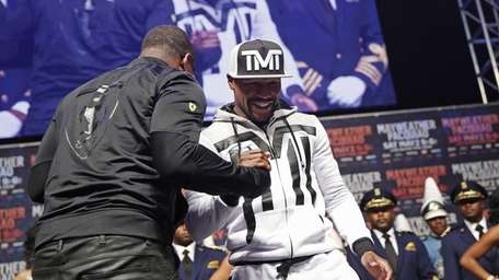Doug E Fresh, left, greets boxer Floyd Mayweather