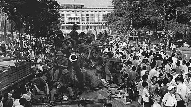 On April 30, 1975, North Vietnamese soldiers sit