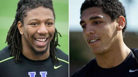 Kentucky's Bud Dupree, left, and Stanford's Andrus Peat